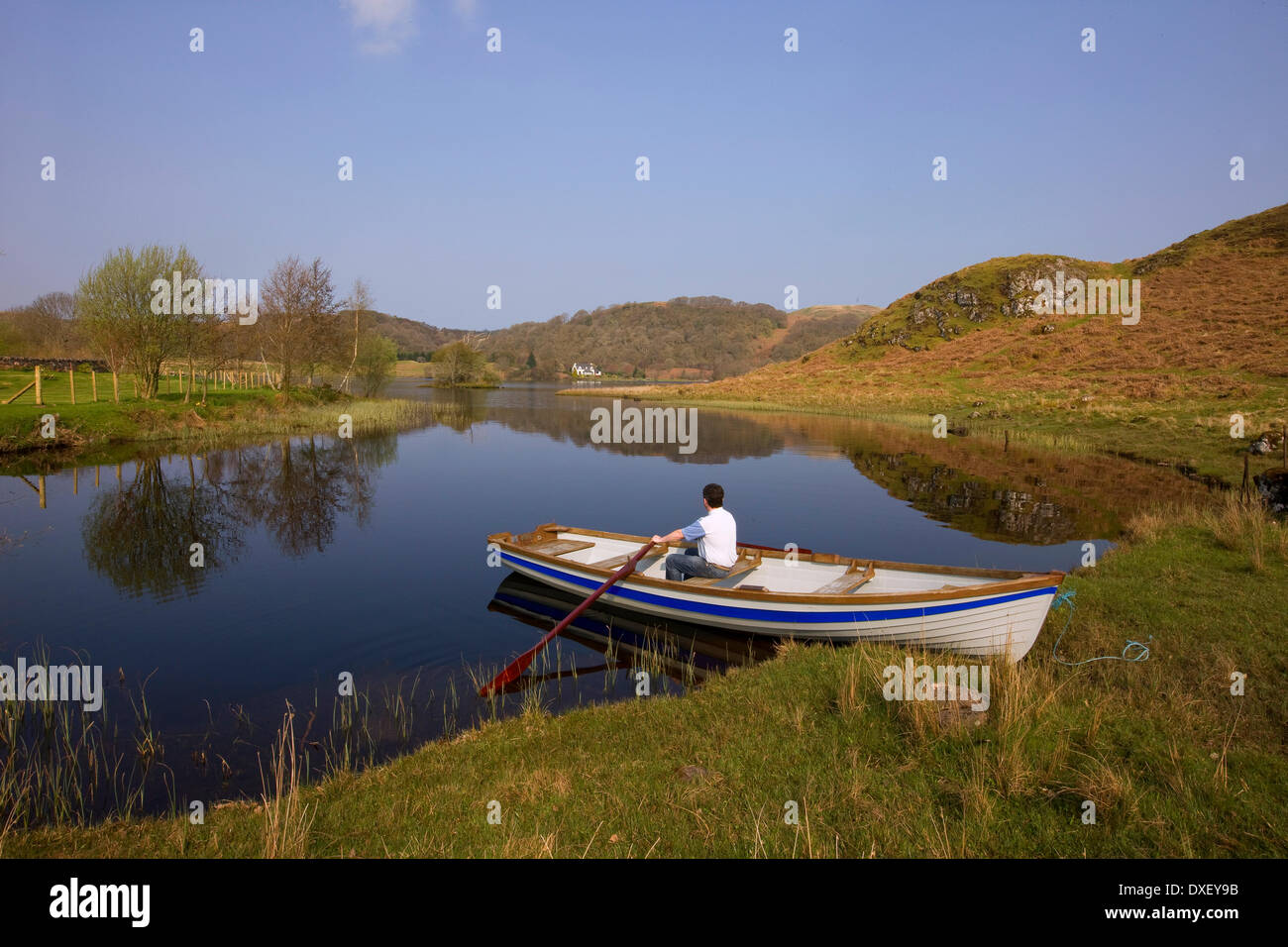Rowing boat on a peaceful loch Nell in argyll - Stock Image