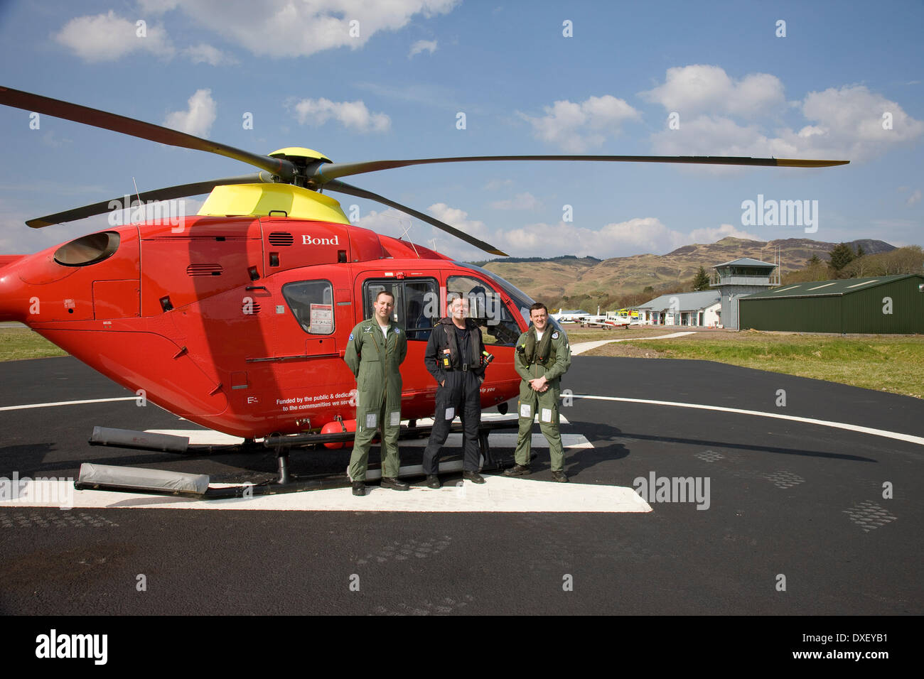 Air Ambulance helicopter & crew at oban Airport, Argyll. - Stock Image
