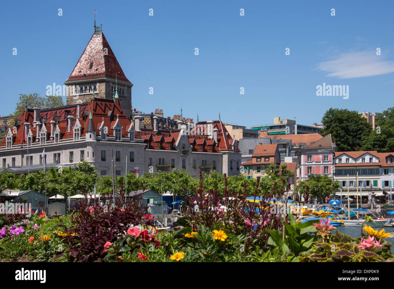 Chateau d'Ouchy and the waterfront in the town of Ouchy on the north shore of Lake Geneva in Switzerland. - Stock Image