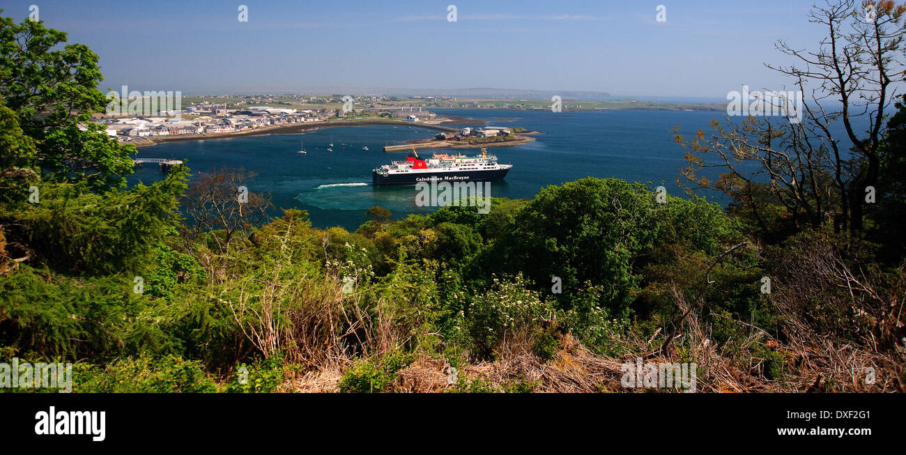 View towards Stornoway harbour with departing Ferry 'Isle of Lewis' outer hebrides - Stock Image