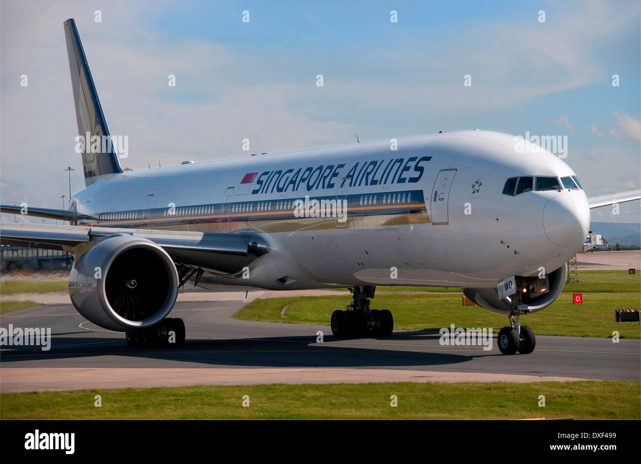 A singapore airlines boeing 777-300 taxis at manchester airport in 2012 england - Stock Image