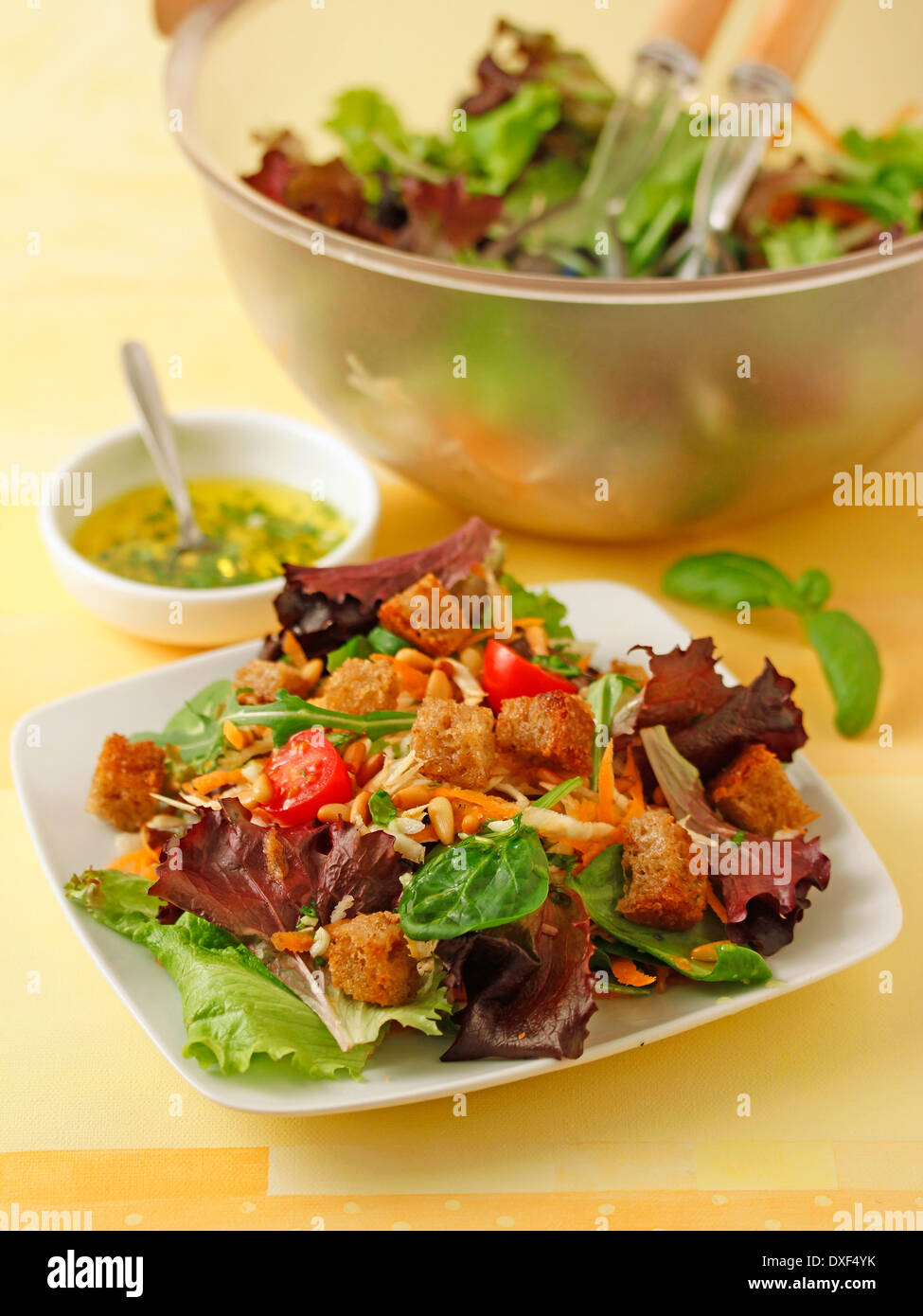 Celeriac salad with pine nuts. Recipe available. - Stock Image