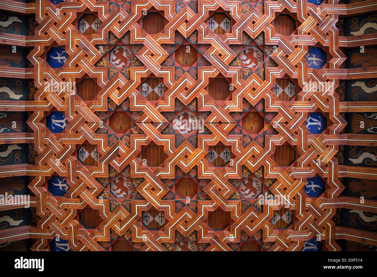 Ornate wooden ceiling design in the cloisters of Toledo Cathedral in the city of Toledo in the La Mancha region of central Spain - Stock Image