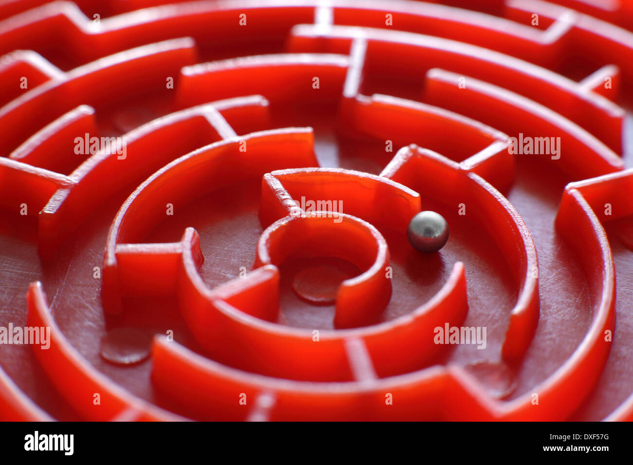 Close up of a small, toy maze. (This is the centre of a small, circular maze which is only 80mm in diameter). - Stock Image