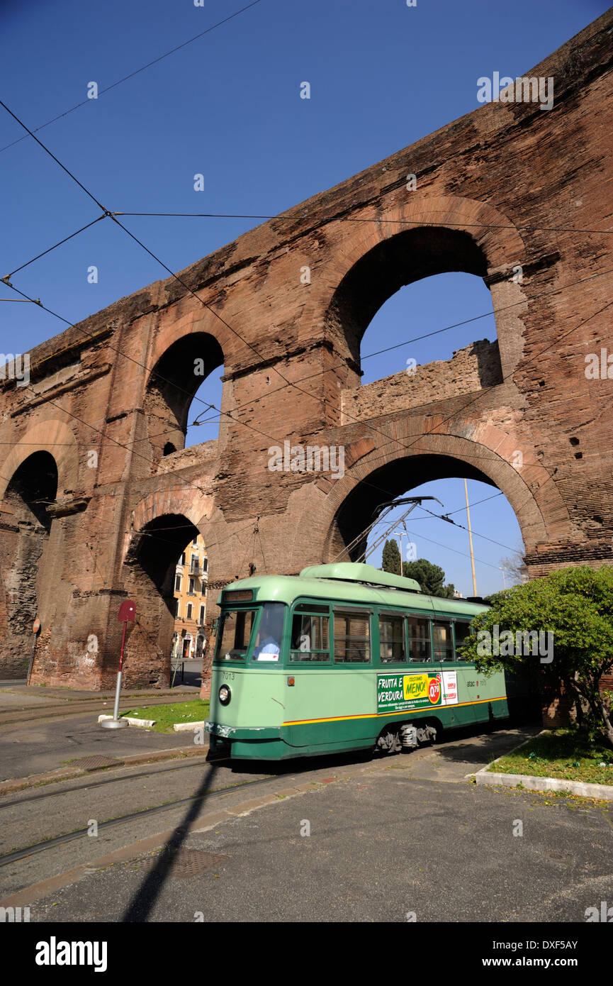 italy, rome, porta maggiore, nero aqueduct, tram - Stock Image