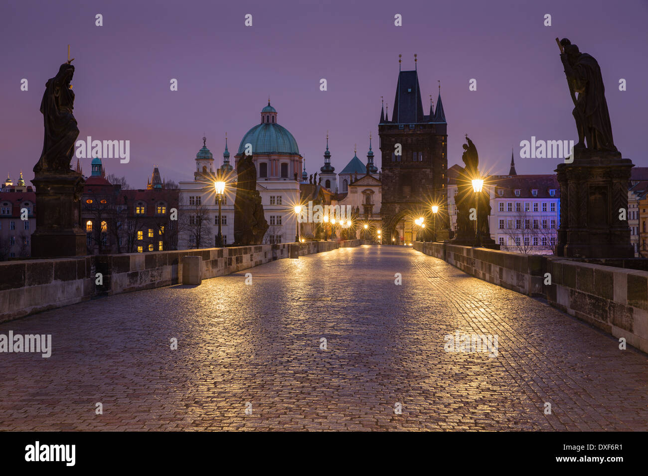 dawn on the Charles Bridge with the towers and spires of the Old Town beyond, Prague, Czech Republic - Stock Image