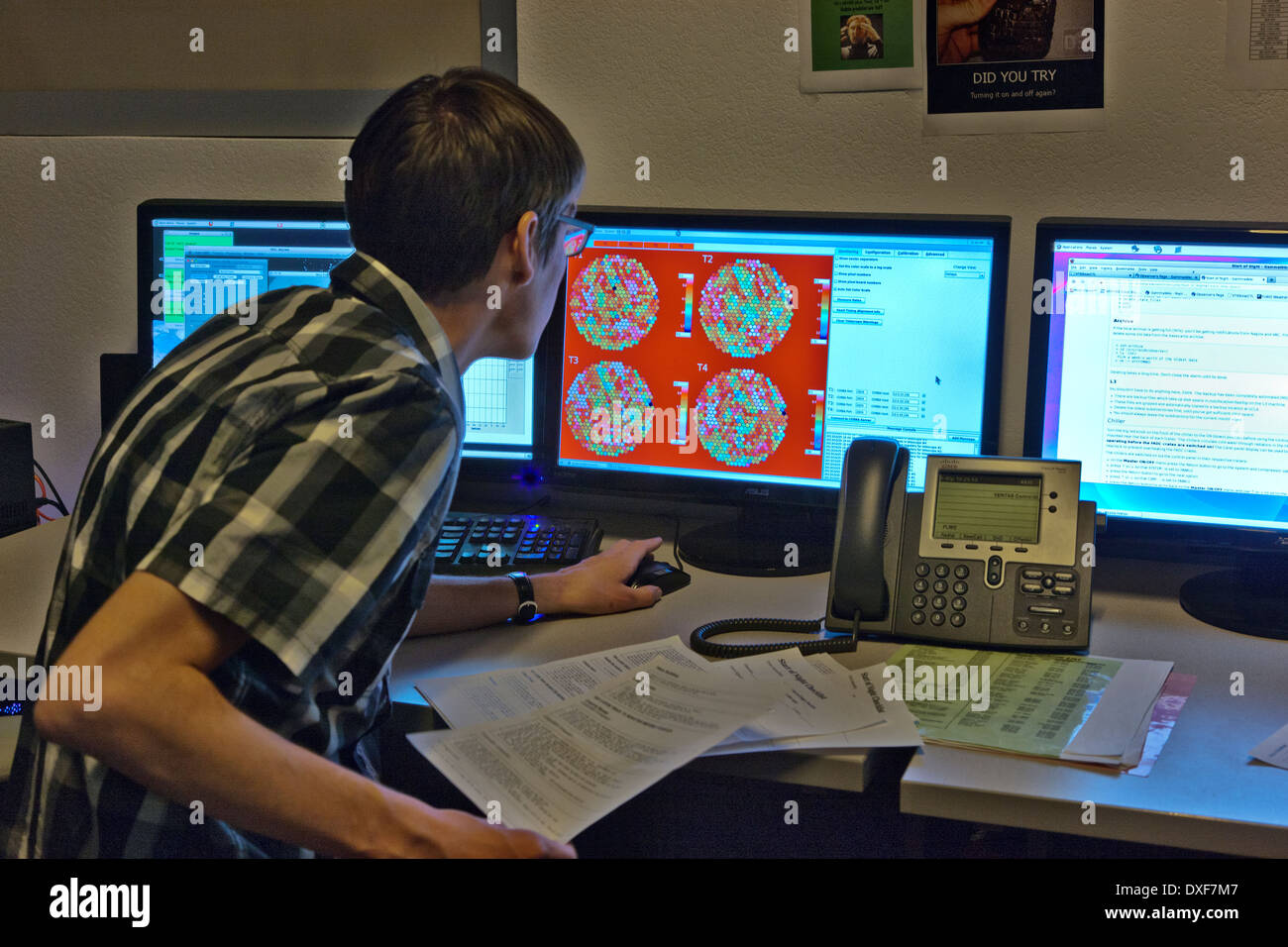 Telescope operator inspecting timing of each pixel. - Stock Image