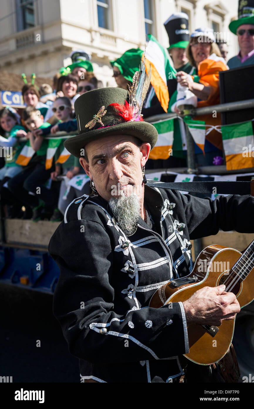 An Irish musician performing during the St Patricks Day Parade in London. - Stock Image