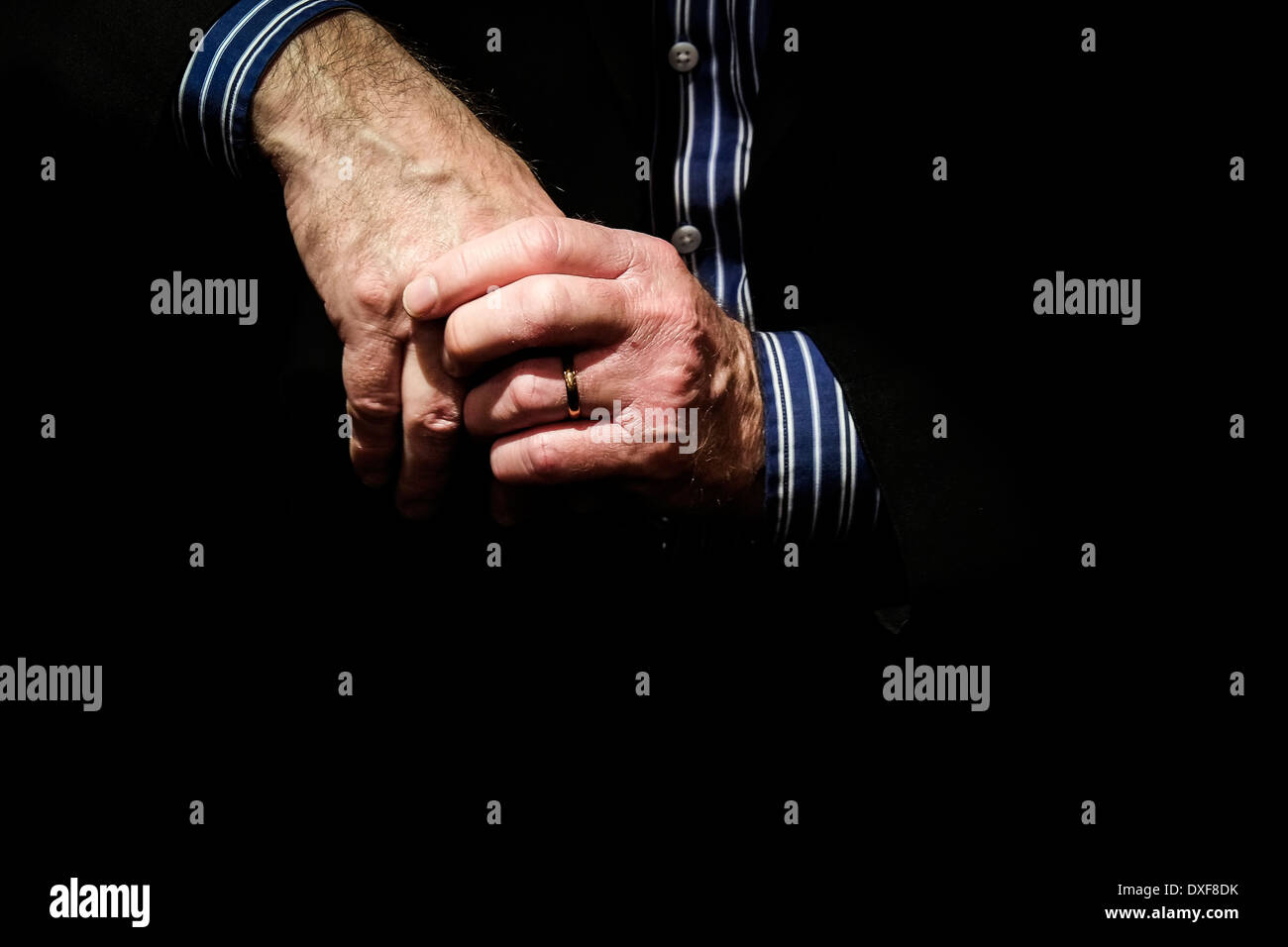 Clasped hands. - Stock Image