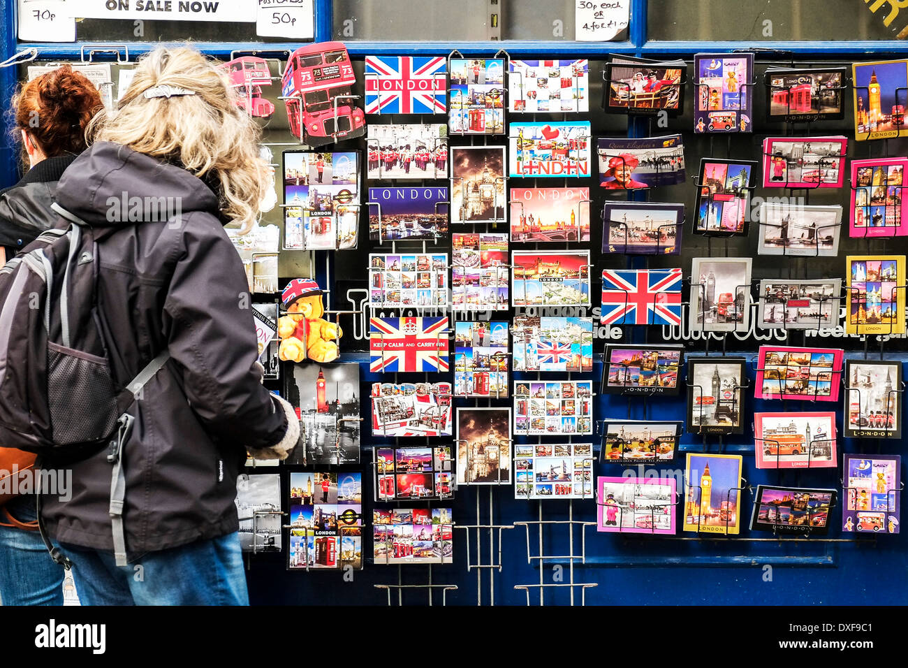 A display of souvenir postcards outside a shop in London. - Stock Image