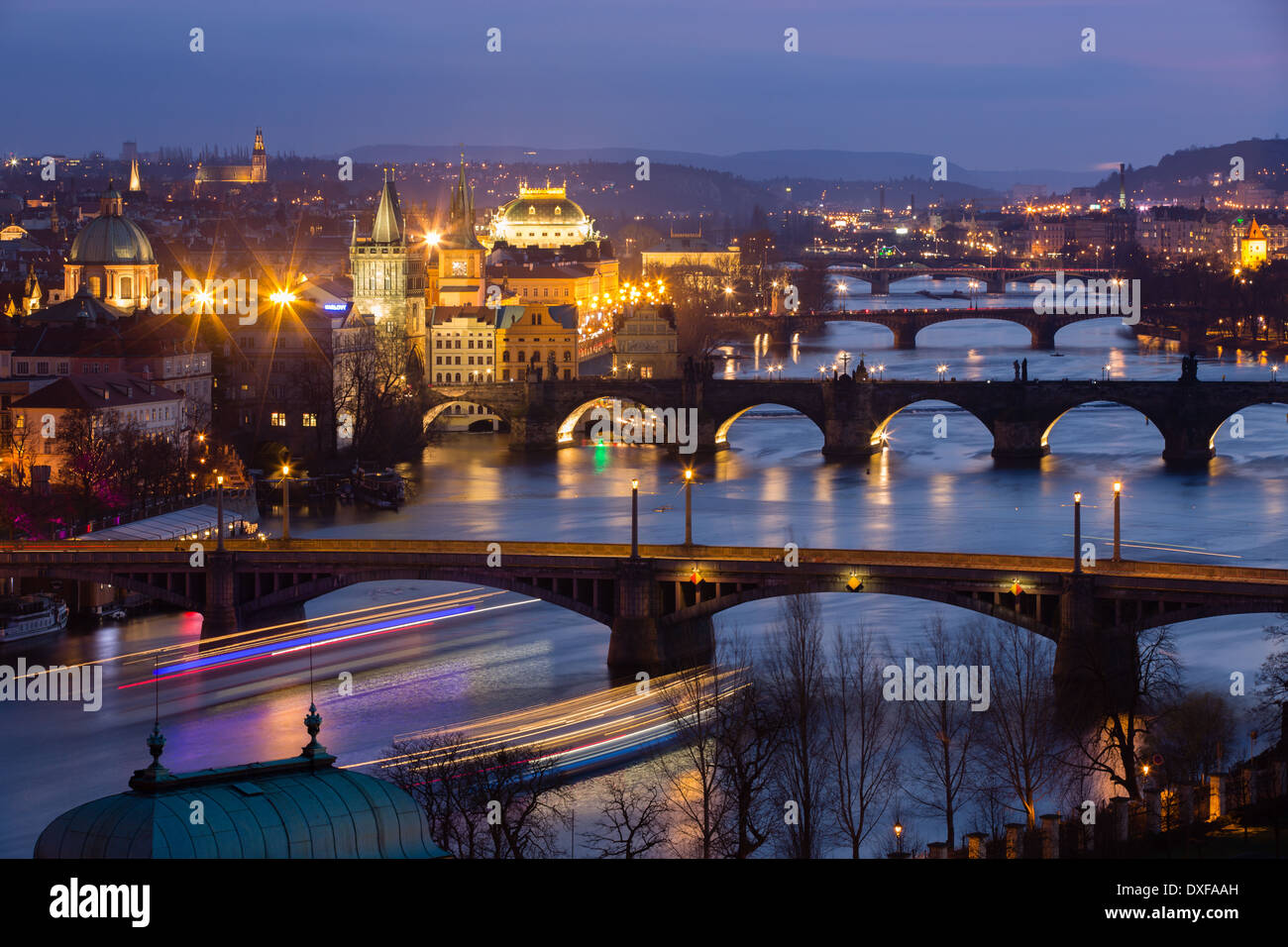 the Manes, Charles and Legion Bridges over the Vltava River at dusk, with the Old Town on the left, Prague, Czech Republic - Stock Image