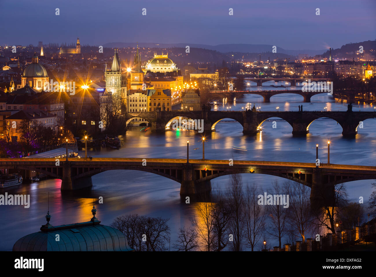 the Manes, Charles and Legion Bridges over the Vltava River at dusk, with the Old Town on the left, Prague, Czech Stock Photo