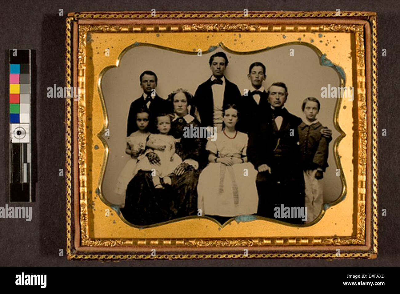 Man and woman with seven children Man and woman with seven children - Stock Image