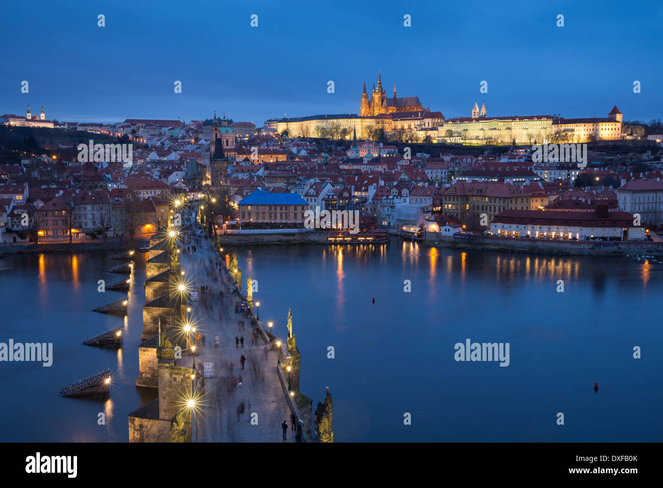 the Charles Bridge over the Vltava River at dusk with the Castle District and St Vitus's Cathedral beyond Prague Stock Photo