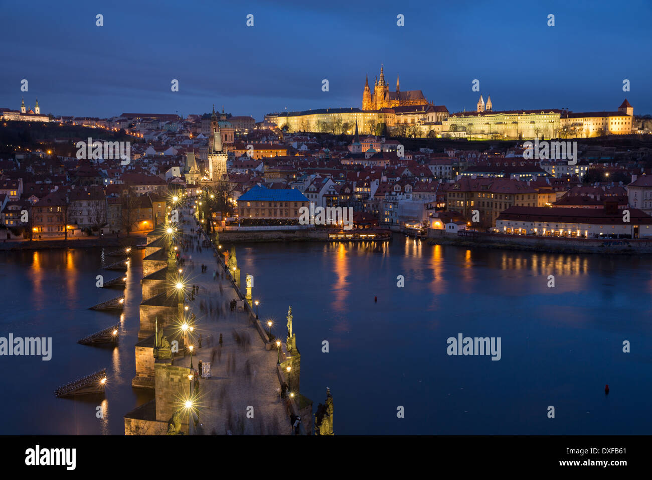 the Charles Bridge over the Vltava River at dusk with the Castle District and St Vitus's Cathedral beyond Prague - Stock Image