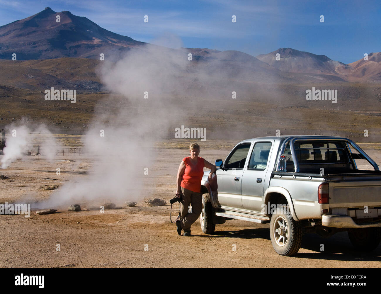 Tourist at the El Tatio Geysers in the Atacama Desert in Chile (Model Released) - Stock Image