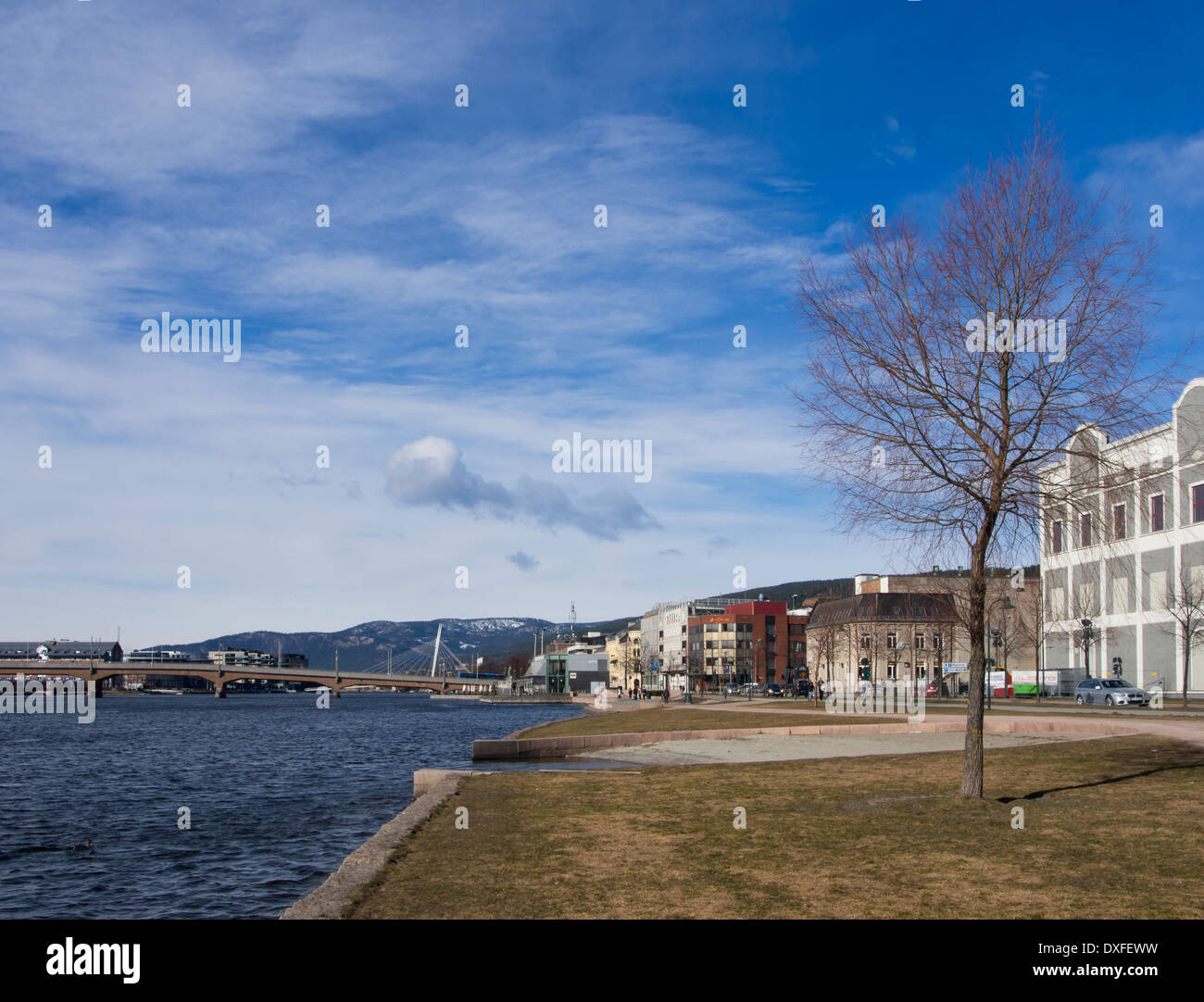 Riverbank with footpaths, beach and decorative installations, modern urban development in Drammen Norway - Stock Image