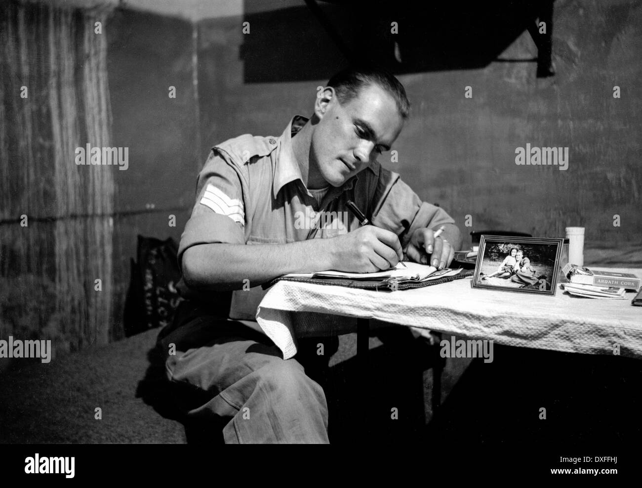A sergeant in the Royal Army Service Corps (RASC) writing home during WW2 from Egypt. - Stock Image