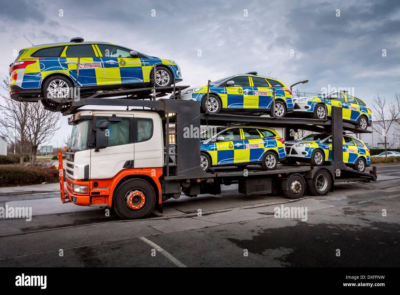 Five Police Cars On Back Of Car Transporter Stock Image