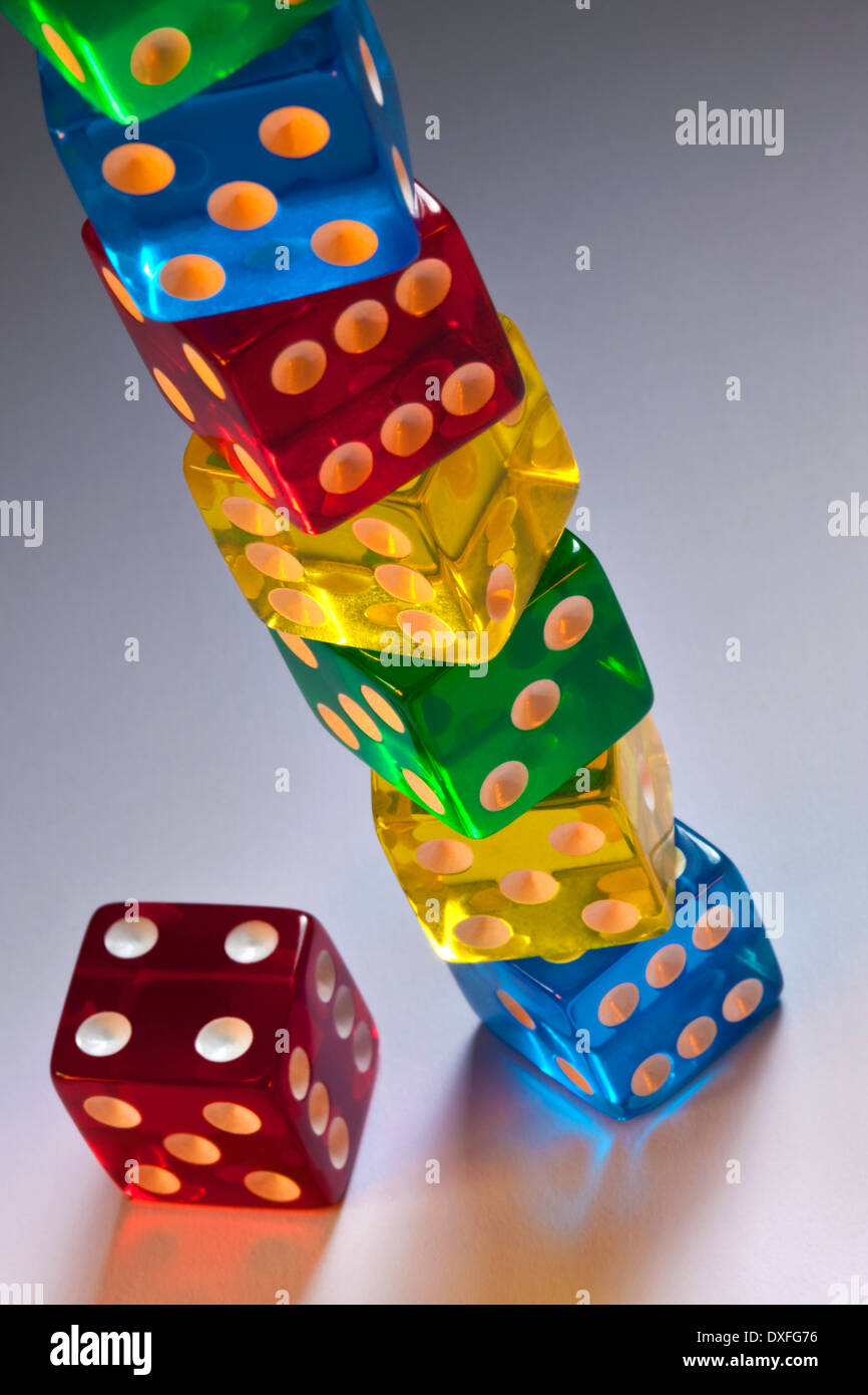 A stack of colored Casino dice. - Stock Image