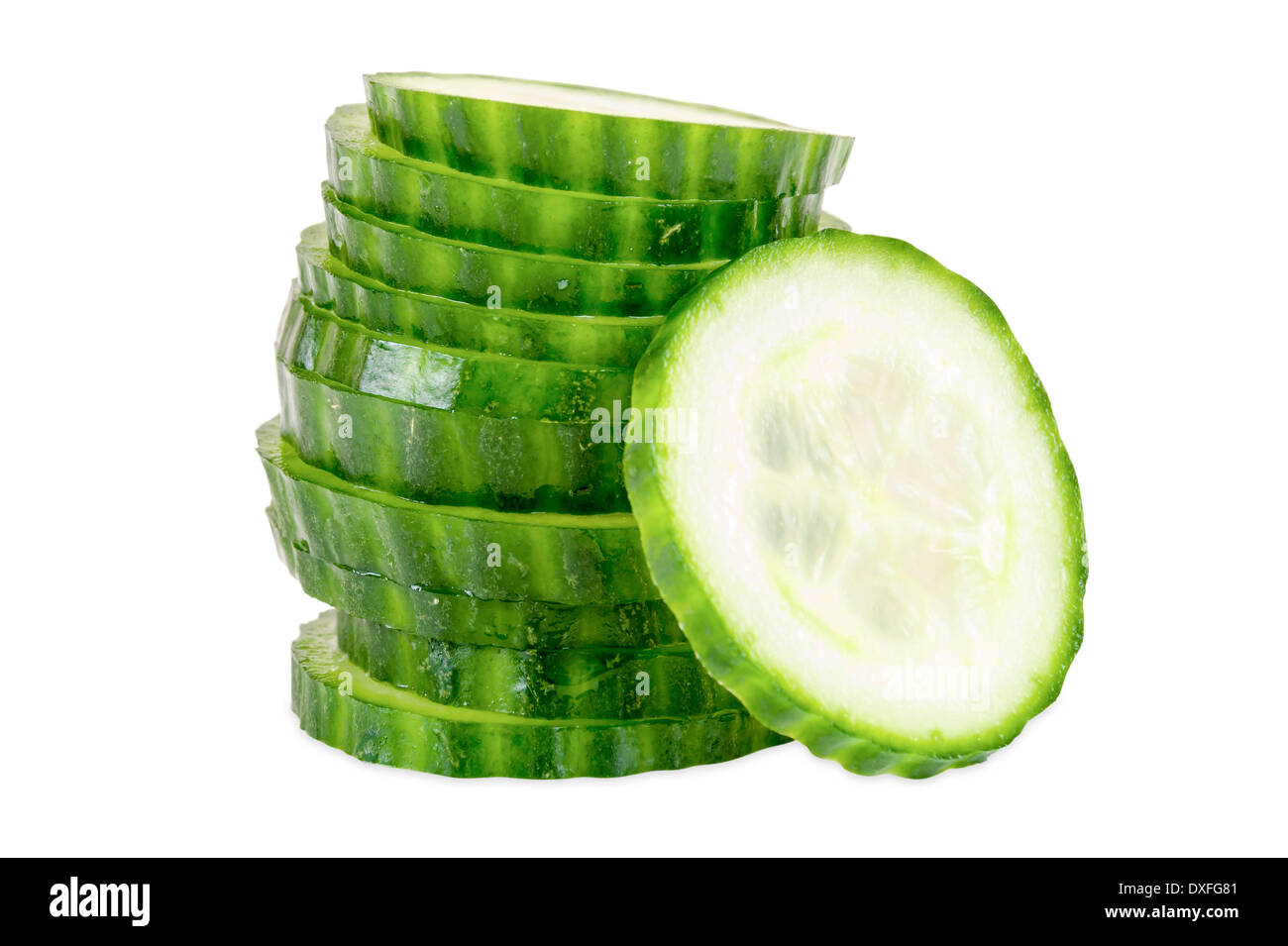 Stack of cucumber slices isolated on white background with clipping path - Stock Image
