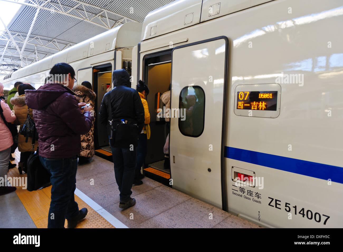 Embarking passengers of a high speed train at train station of Changchun.. Jilin Province, China - Stock Image