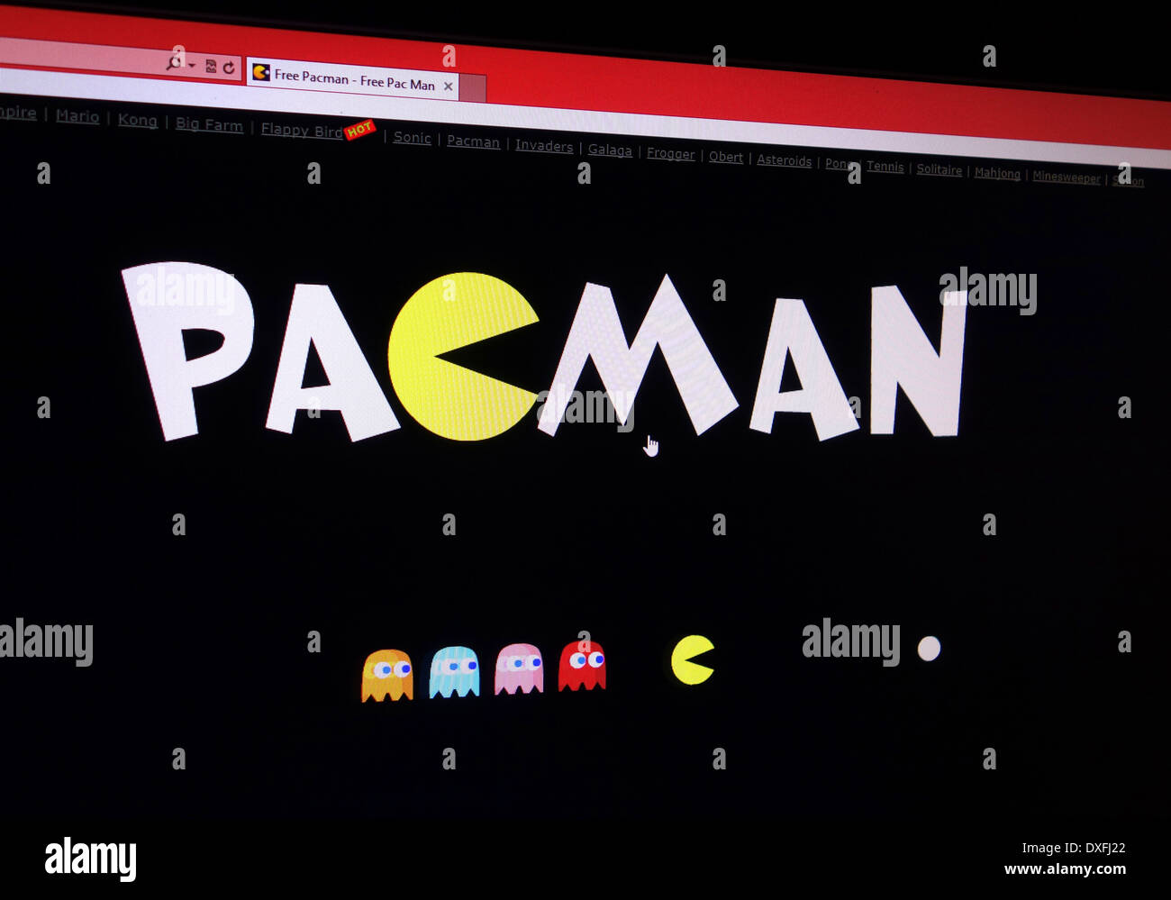 Pacman. 80's classic arcade game - Stock Image
