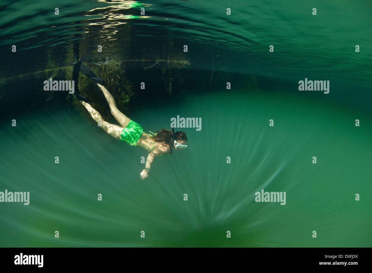 Snorkeling in green Marine Lake, Raja Ampat, West Papua, Indonesia - Stock Image