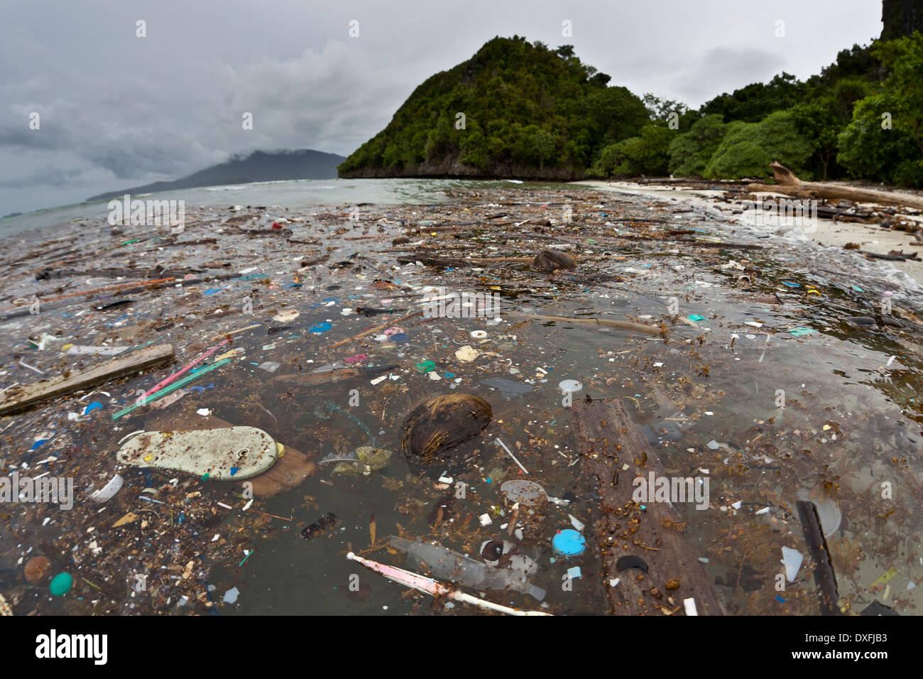Plastic Waste washes ashore, Raja Ampat, West Papua, Indonesia - Stock Image