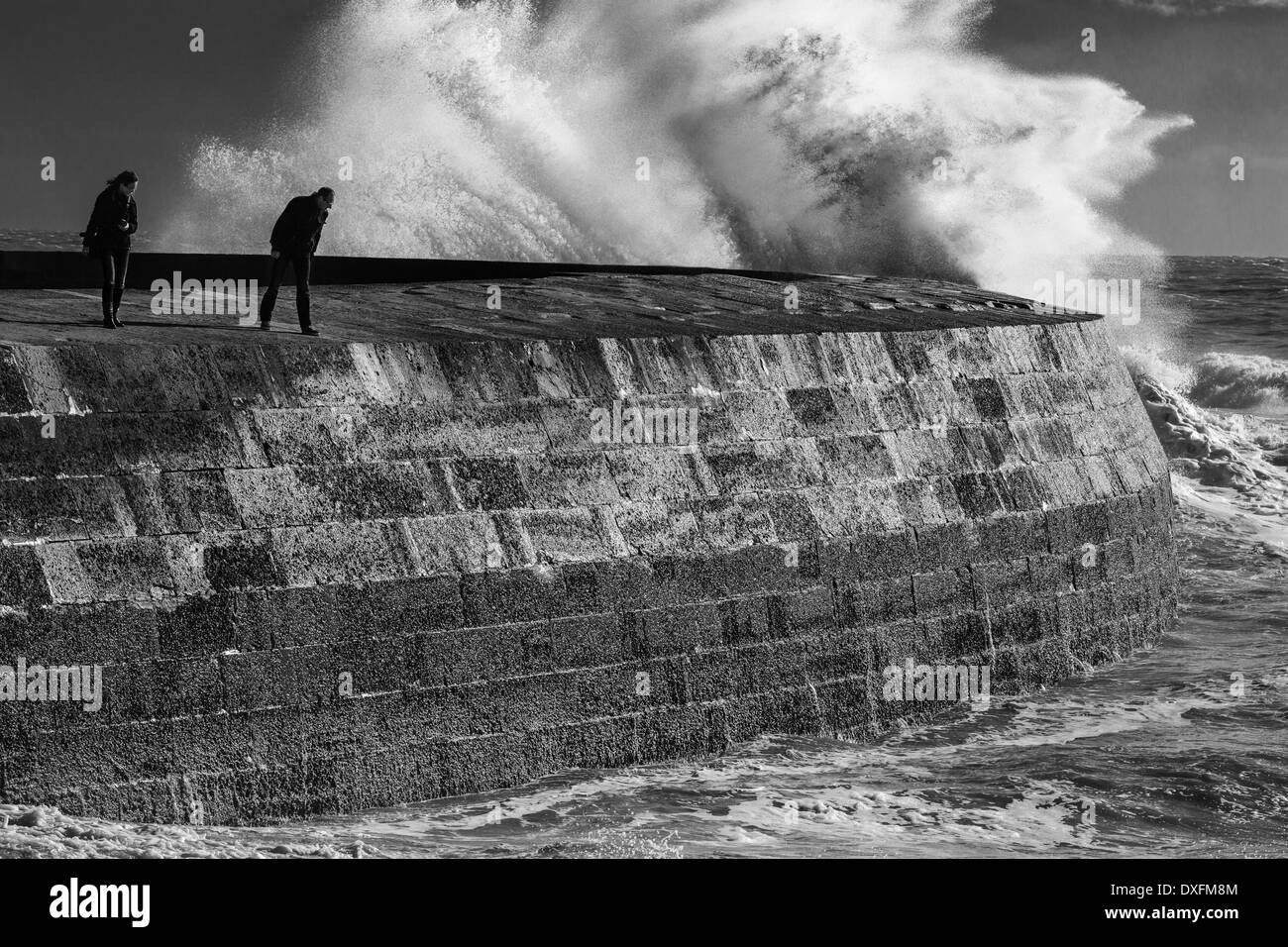 Exploring the Cobb in a strom, Lyme Regis, Dorset, Jurassic Coast, England, UK - Stock Image