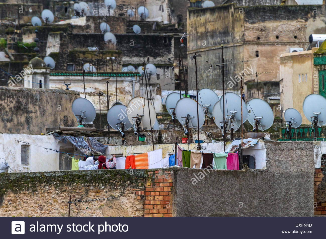 View of satellite dishes and television aerials on roof of houses - Morocco - Stock Image