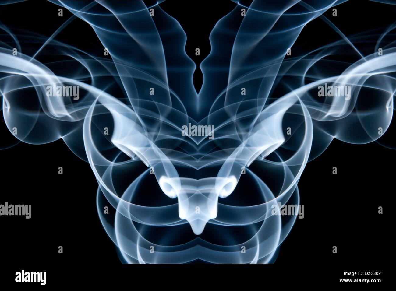 Smoke swirls made into an abstract design. - Stock Image