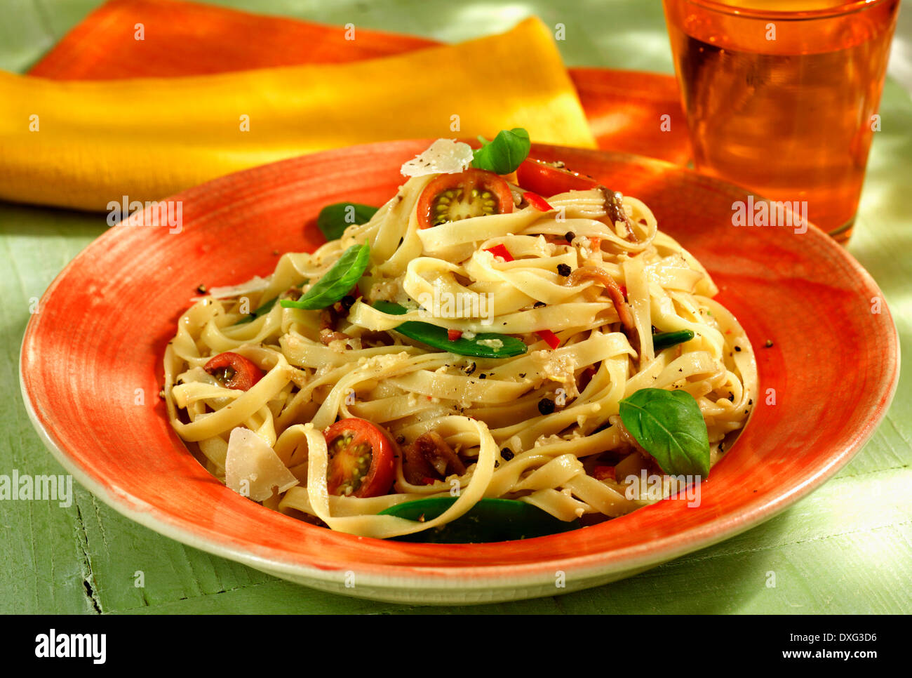 Plate Of Fettuccine With Anchovies And Basil - Stock Image