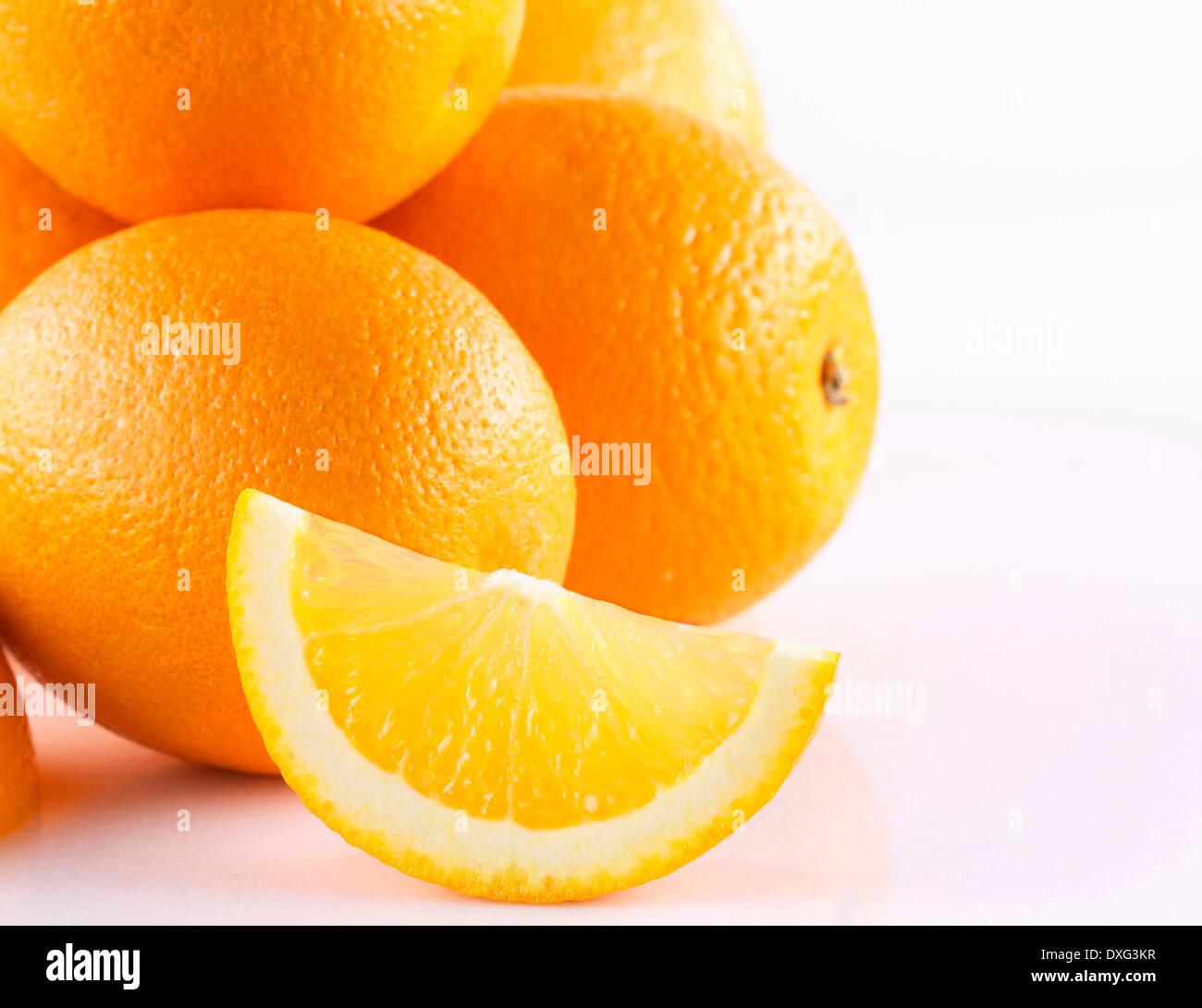 Studio Shot Of Oranges On White Background - Stock Image