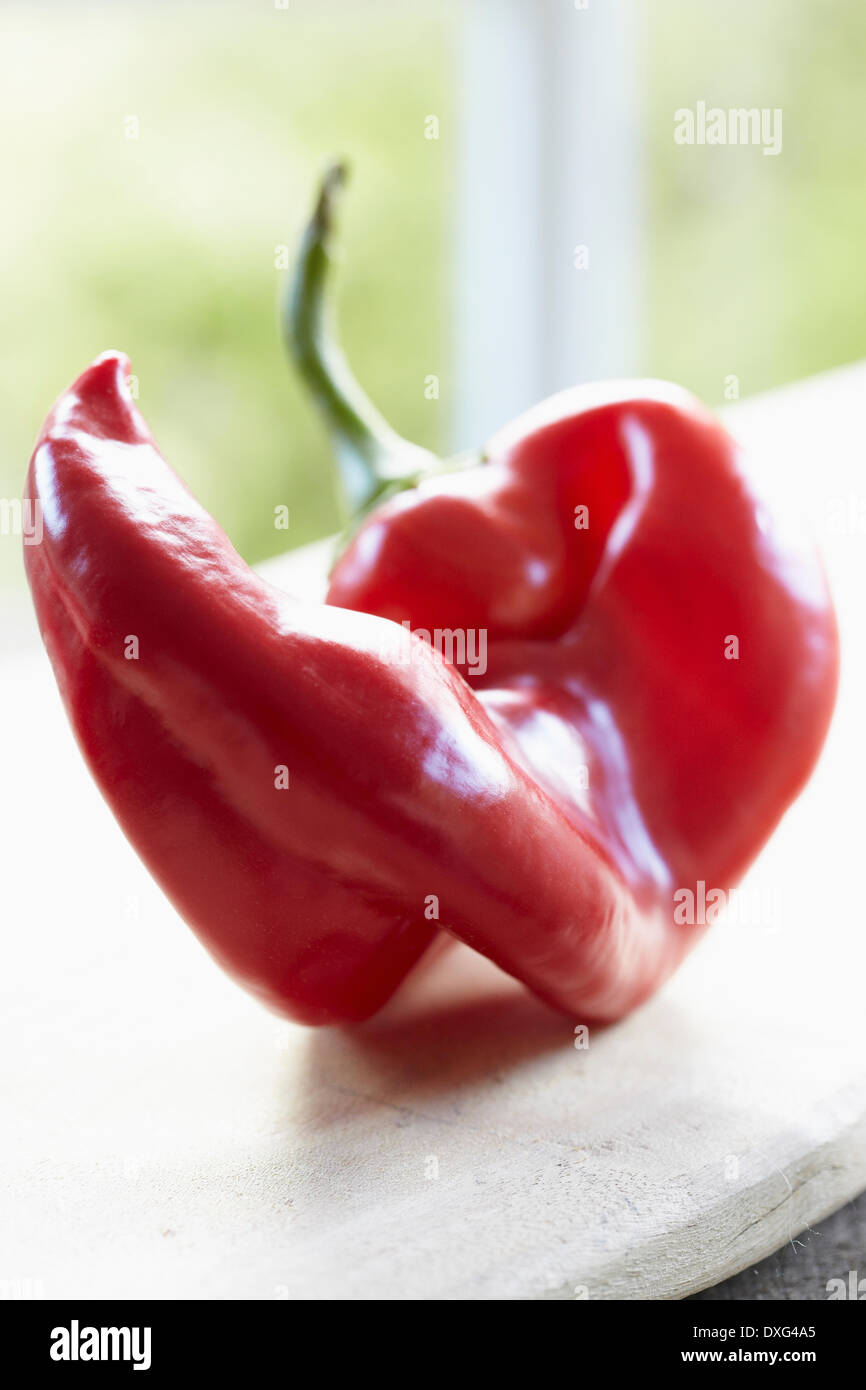 Red Romano Pepper On Wooden Surface Stock Photo