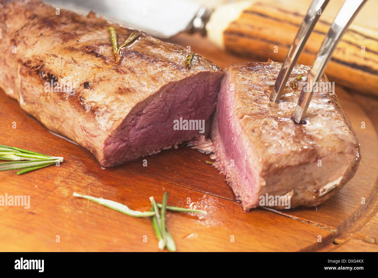 Roast Loin Of Venison Being Carved - Stock Image