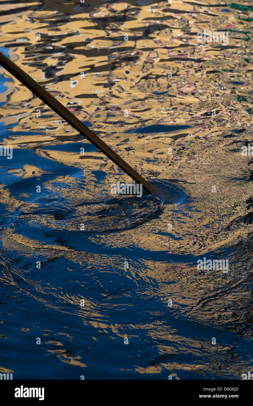 Gondolier's oar stirring water in Venice, Italy - Stock Image