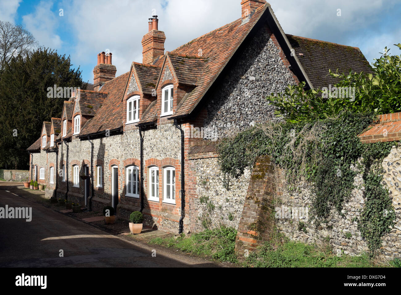 Row of brick and flint terraced cottages Hambleden village Buckinghamshire UK - Stock Image