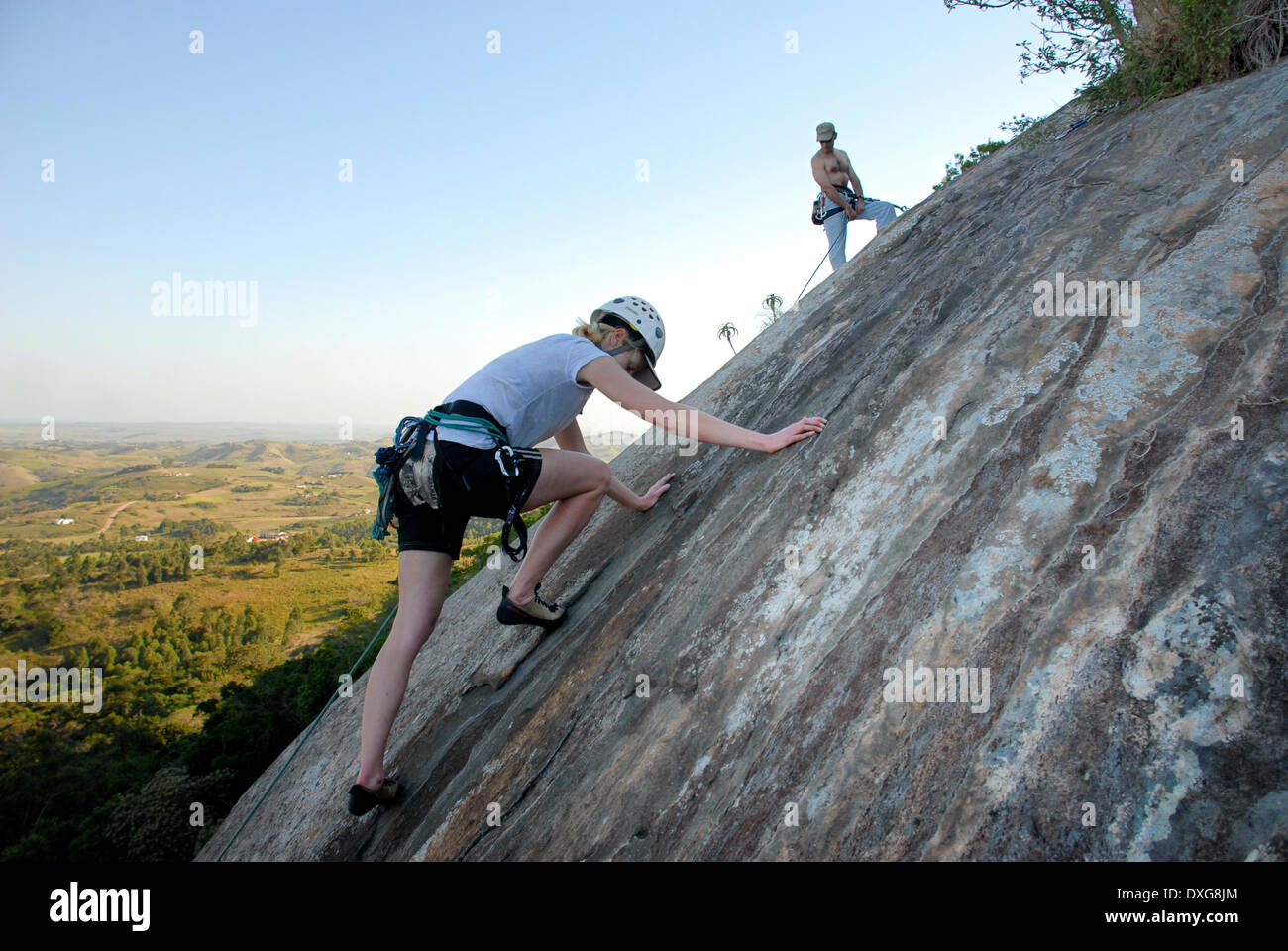 Climber relying on friction on granite slab, Ongoye Forest Reserve - Stock Image