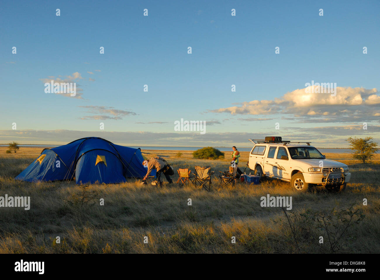 Camping at the edge of the flooded Sowa Pan in the Makgadikgadi Pans, Botswana. Stock Photo
