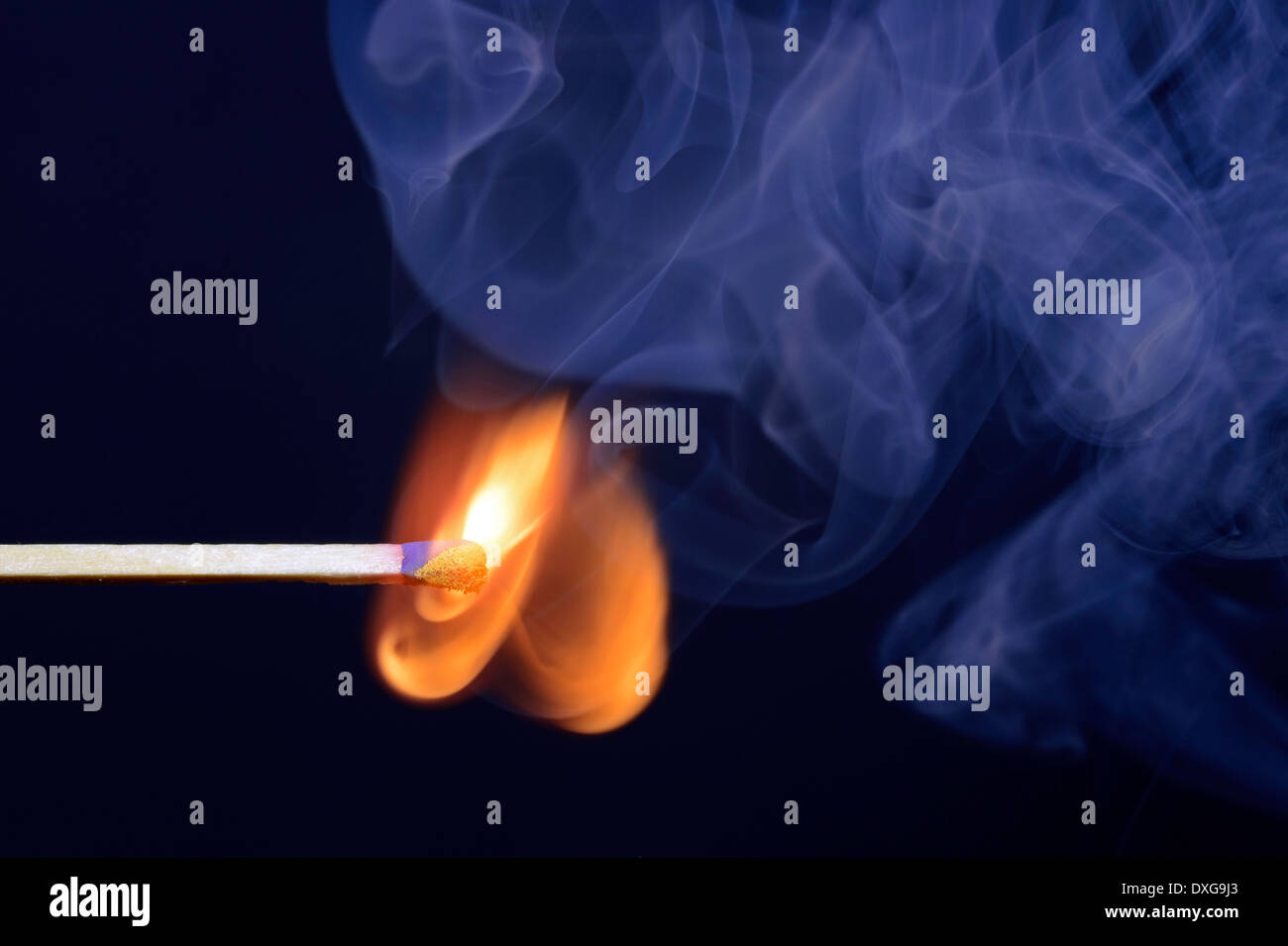 Matchstick being ignited - Stock Image
