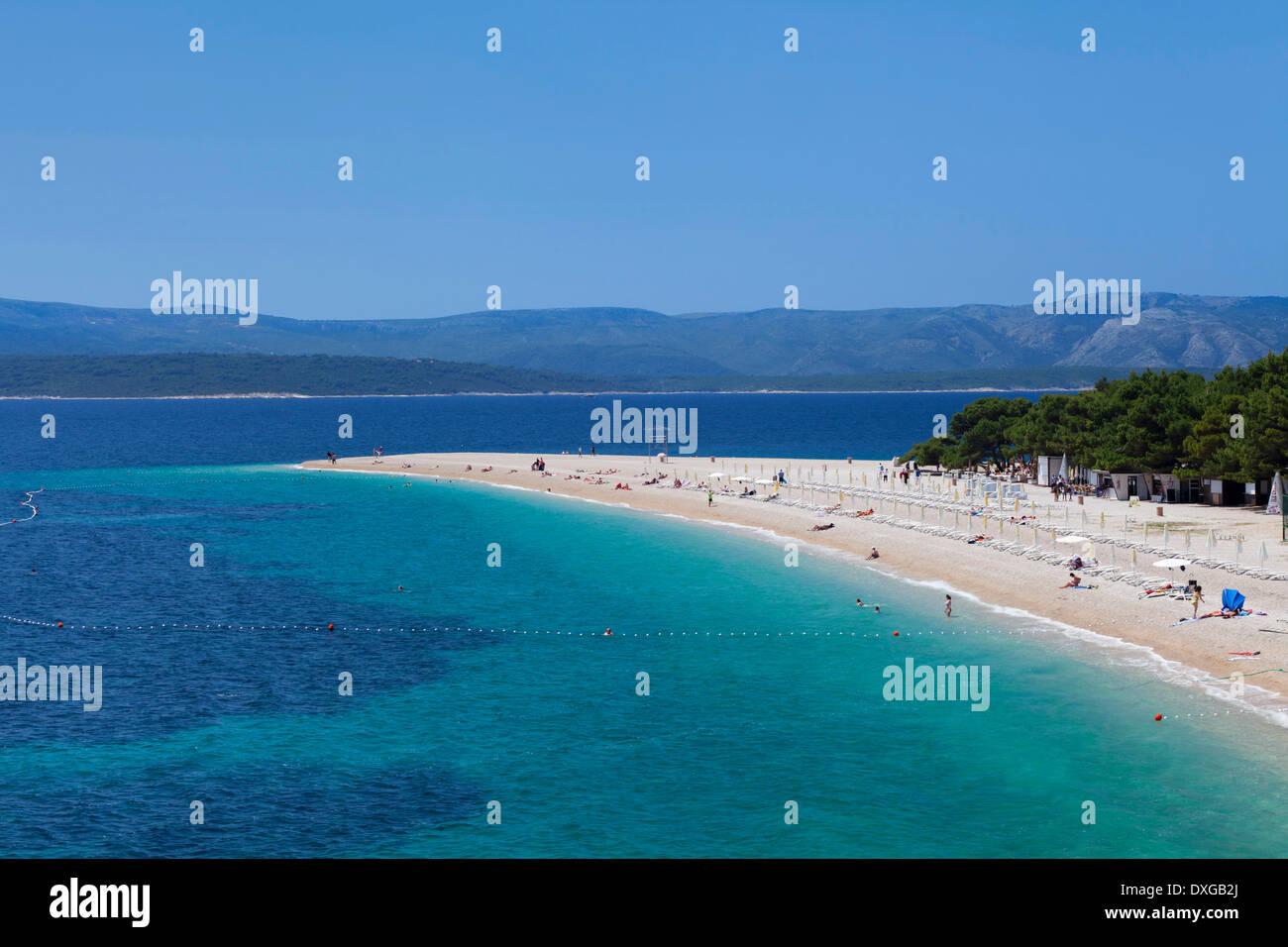 Beach at Zlatni Rat or Golden Horn, island of Hvar at the back, Bol, Island of Brač, Dalmatia, Croatia - Stock Image