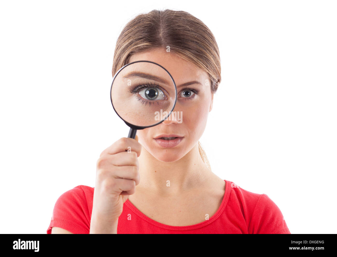 Beautiful woman looking through a magnifying glass, isolated on white - Stock Image