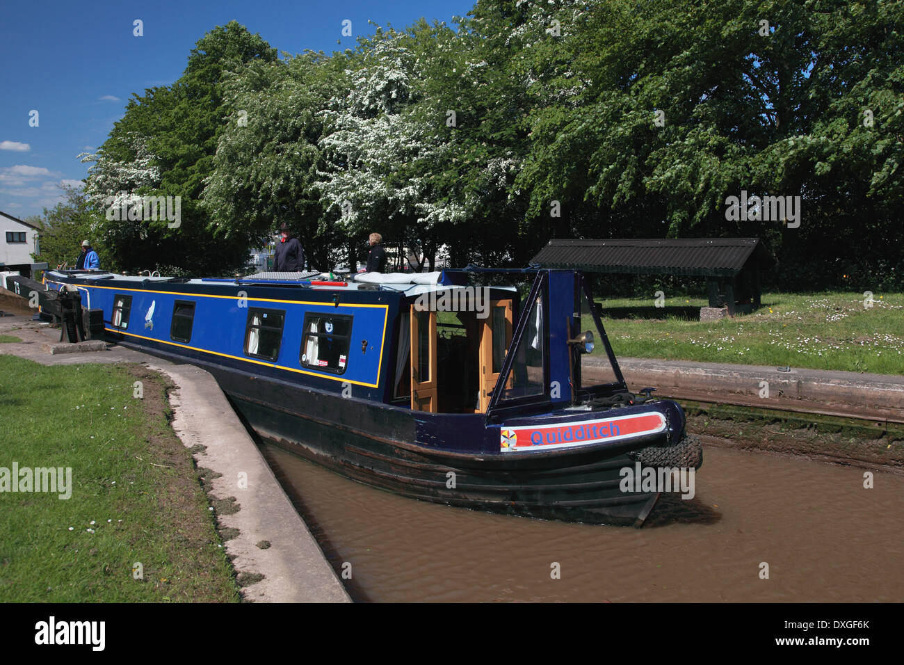 A narrowboat leaving Lock 73 travelling towards Kings Lock on the Trent and Mersey Canal at Middlewich - Stock Image