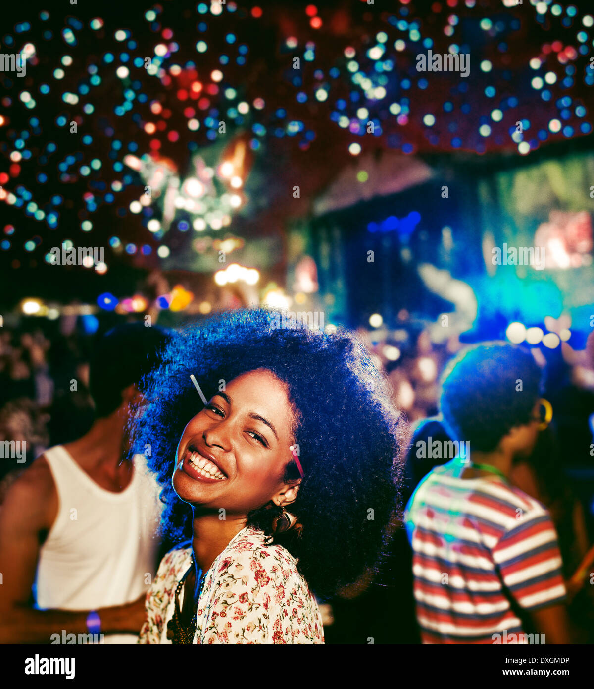 Portrait of enthusiastic woman at music festival - Stock Image