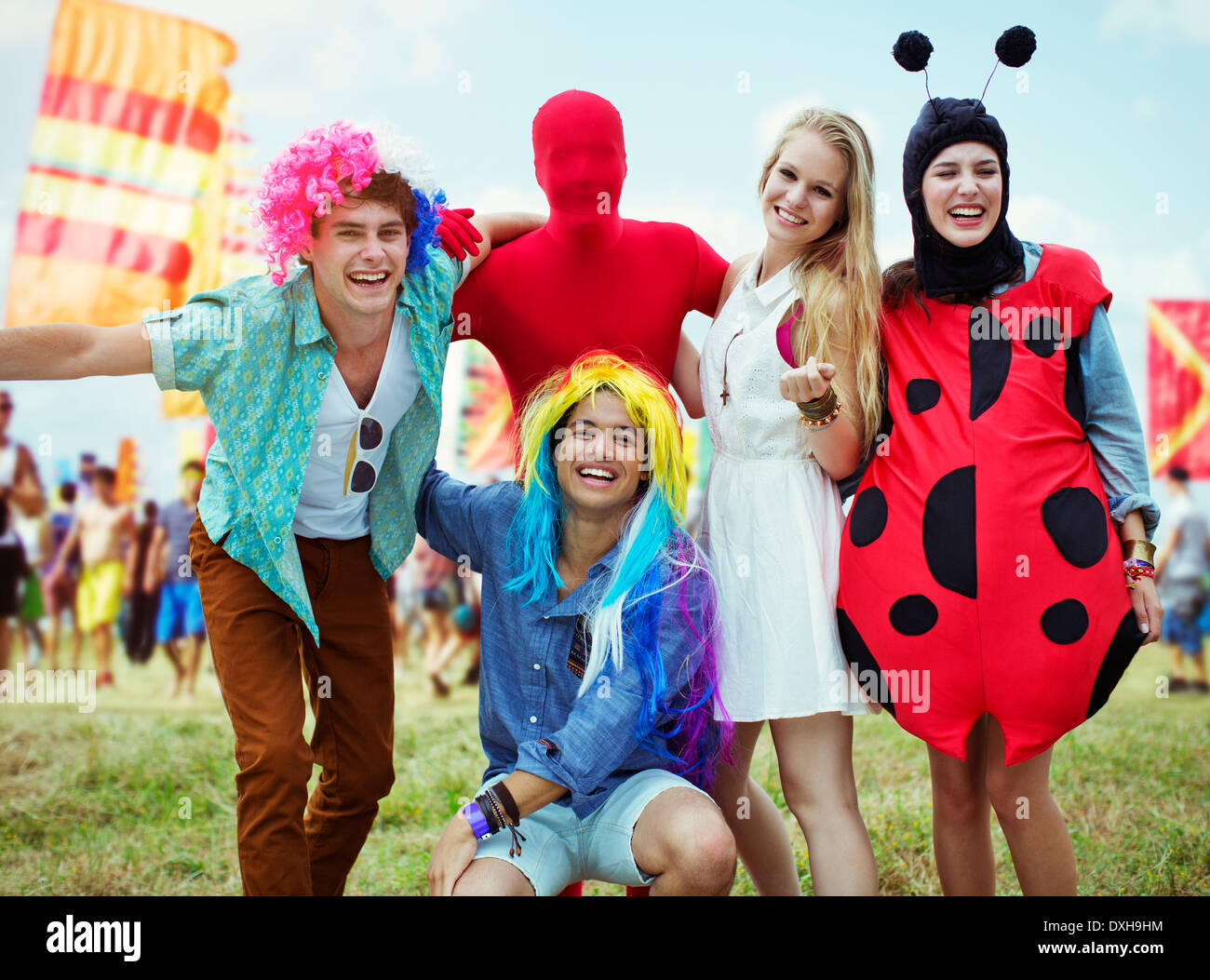 Portrait of friends in costumes at music festival - Stock Image