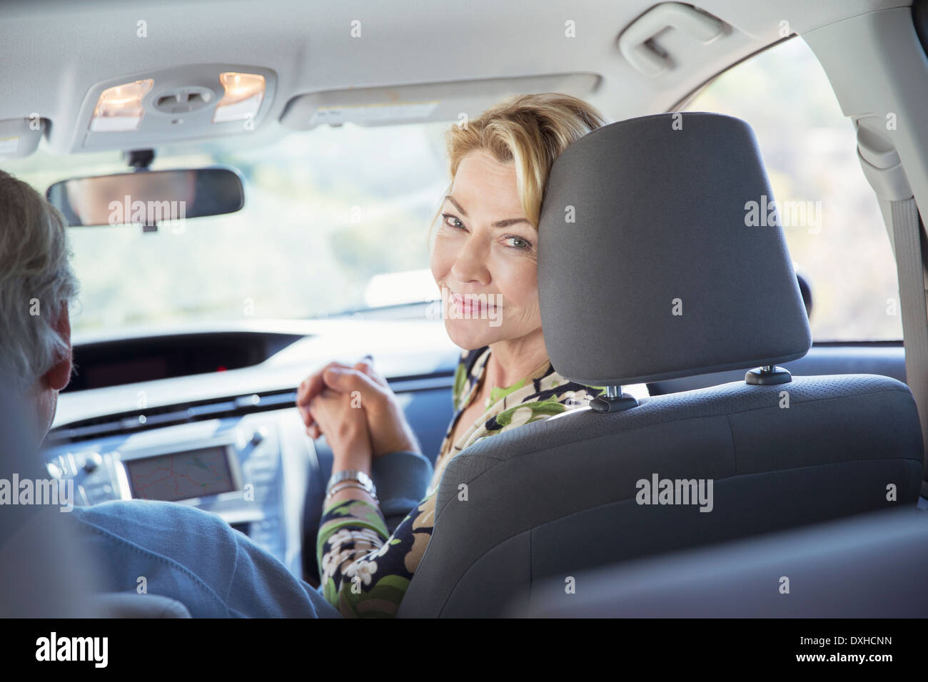 Portrait of smiling woman inside car - Stock Image