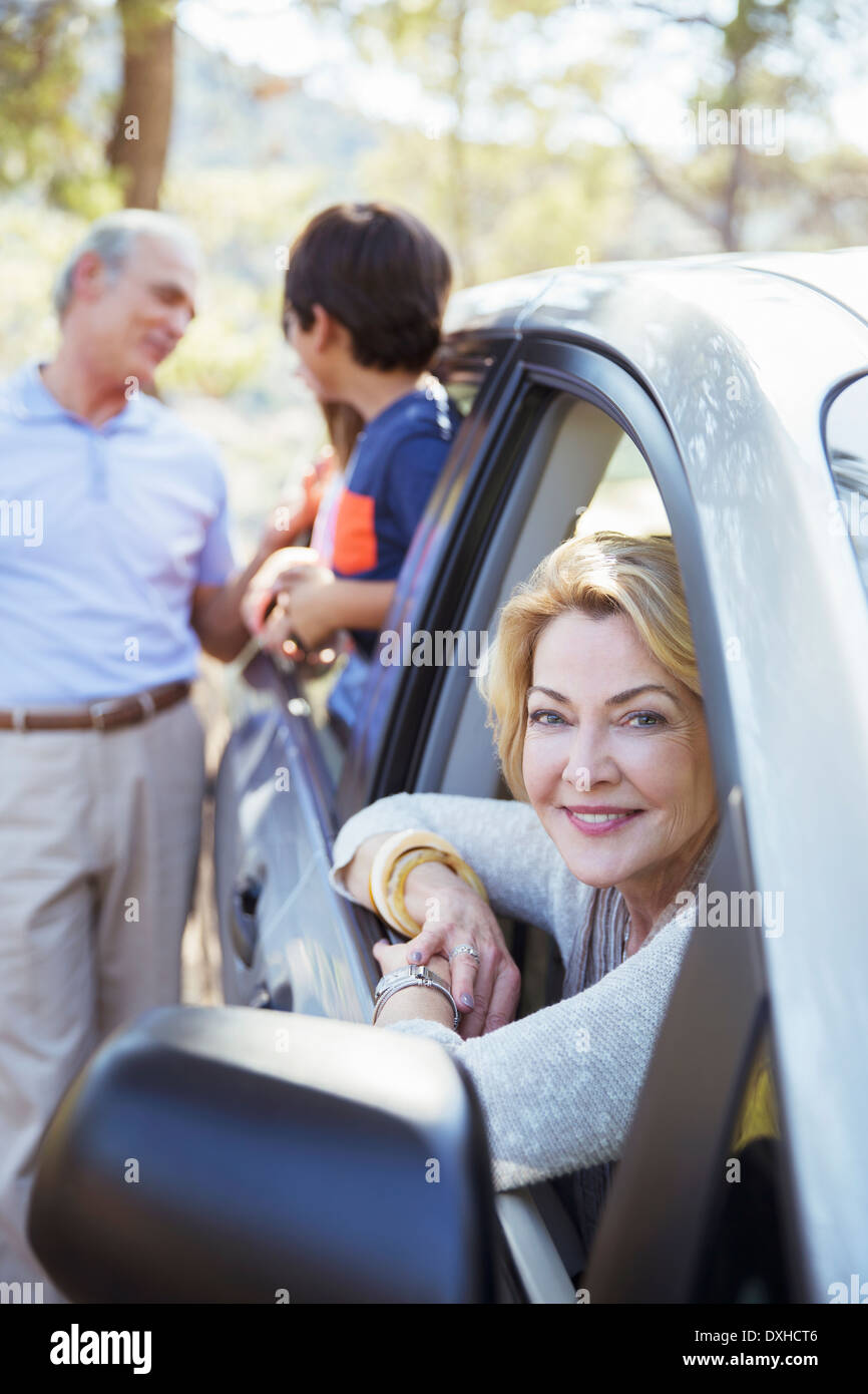 Grandparents and grandchildren inside and outside car - Stock Image