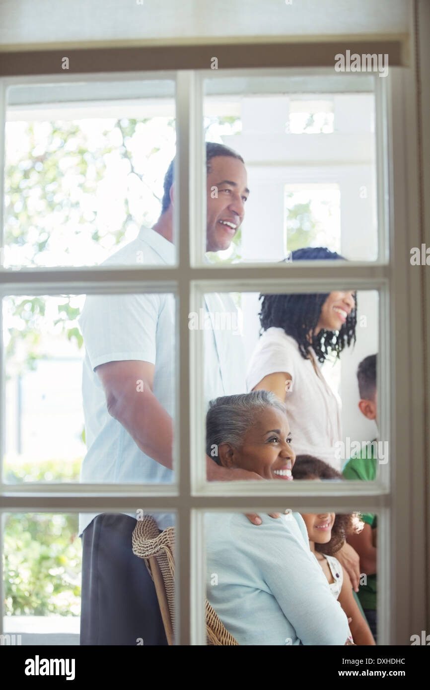 Happy multi-generation family on porch - Stock Image