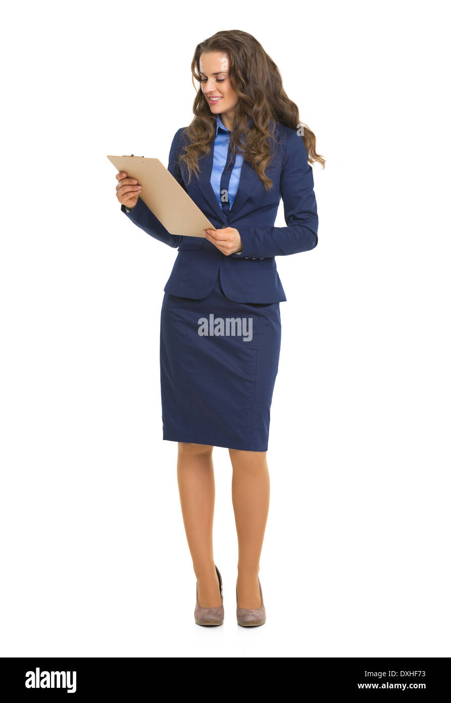 Full length portrait of business woman with clipboard - Stock Image